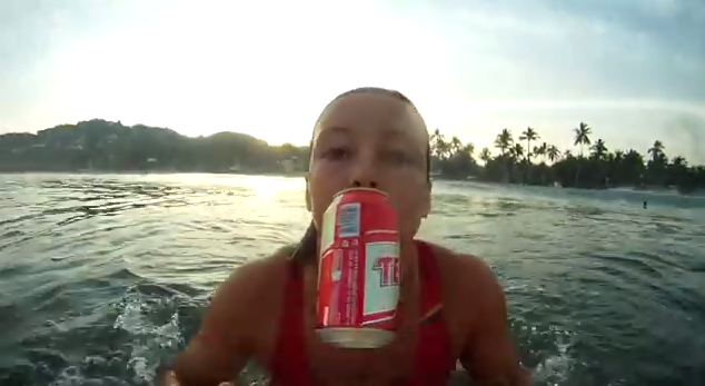 Girl surfing with drink for neknominate