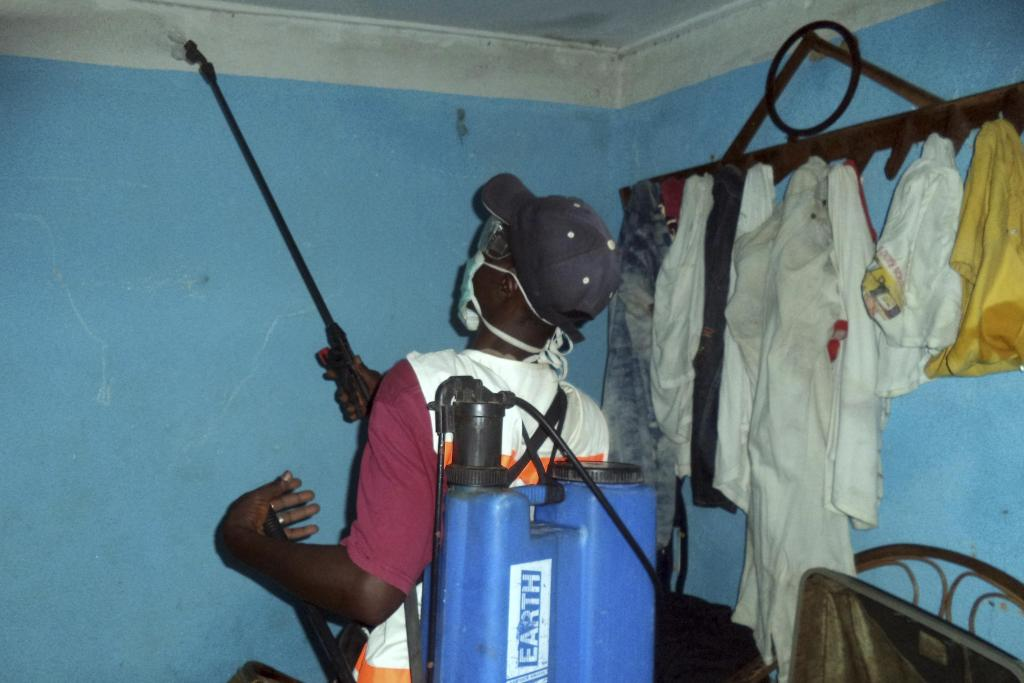Disinfecting hospital room in Guinea