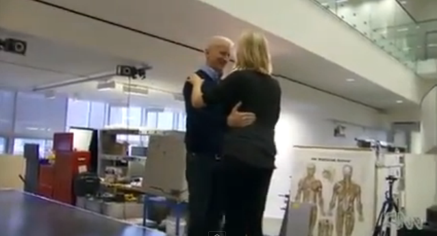Adrianne Haslet-Davis and Anderson Cooper dance together on stage