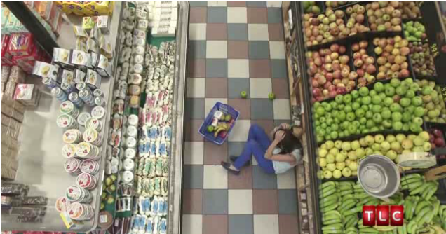 Ashley hits head on produce and falls to the ground