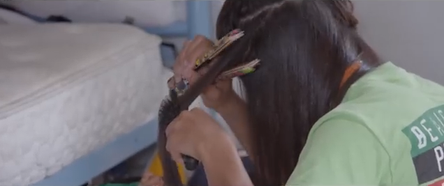 Saelua straightens hair
