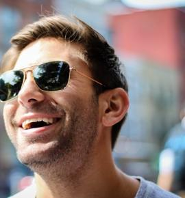 Man with sunglasses smiling
