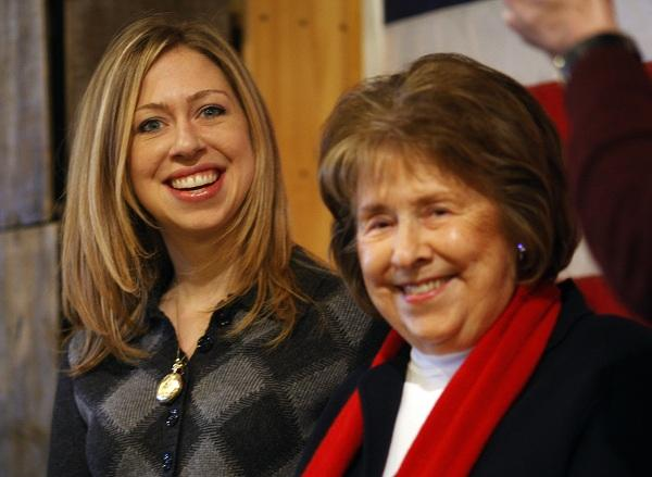 Chelsea Clinton (L) and her grandmother Dorothy Rodham (R) listen as Democratic presidential candidate U.S. Senator Hillary Clinton (D-NY) speaks to voters in Concord, New Hampshire December 21,2007.