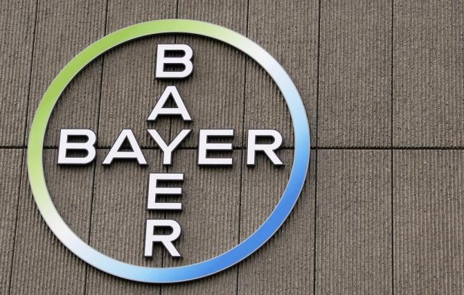 The logo of Germany's largest drugmaker Bayer HealthCare Pharmaceuticals is pictured on the front of its building in Berlin.