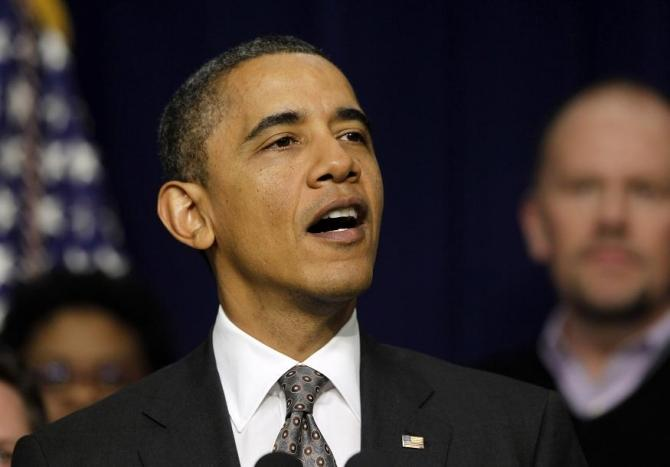 U.S. President Barack Obama makes a statement in the Eisenhower Executive Office Builiding on the extension of payroll tax cuts being debated on Capitol Hill in Washington, December 22, 2011.