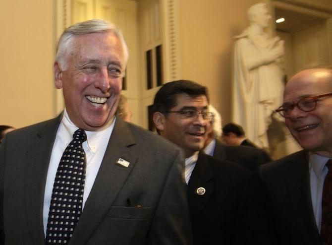 House Minority Whip Steny Hoyer (D-MD) (L) smiles after the House vote on the payroll tax cut extension on Capitol Hill in Washington December 23, 2011.