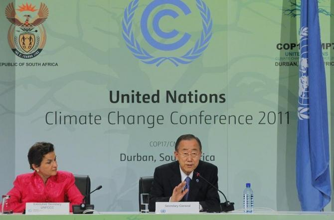United Nations Framework Convention on Climate Change Executive Secretary Christiana Figueres listens as UN Secretary-General Ban Ki-moon addresses a media conference at the UN Climate Change conference (COP17) in Durban, December 6, 2011.