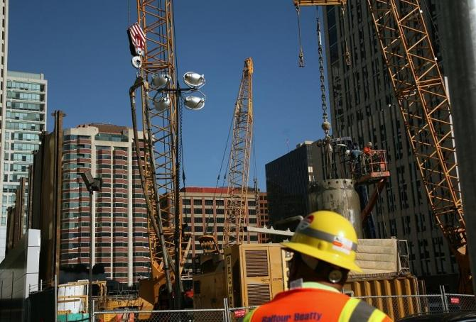 A worker stands in front of a construction site in San Francisco, California January 5, 2012.
