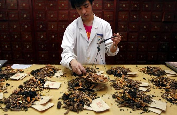 A worker prepares traditional Chinese herbal medicines at Beijing's Capital Medical University Traditional Chinese Medicine Hospital May 25, 2011.