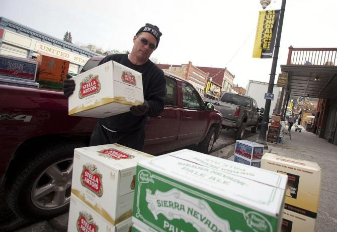 "Troy Ruesch unloads alcohol for the ""No Name Saloon"" before the first day of Sundance Film Festival in Park City, Utah January 18, 2012."