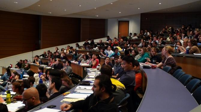 College students attend lecture in a classroom.