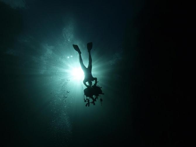 A scuba diver removes his equipment as he prepares to exit La Cueva de los Peces (Cave of the Fish) along the coast of Playa Giron, near the Bay of Pigs, 160 km (100 miles) south-east of Havana, in central Cuba January 24, 2012.