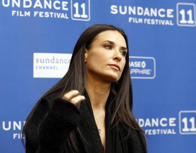 """Cast member Demi Moore poses at the premiere of """"Another Happy Day"""" at the Sundance Film Festival in Park City, Utah January 23, 2011."""