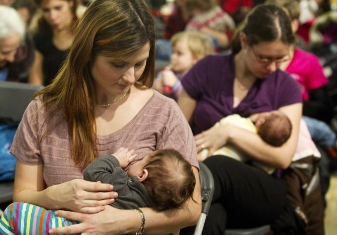 Mothers participate in a breastfeeding demonstration in Montreal January 19, 2011.