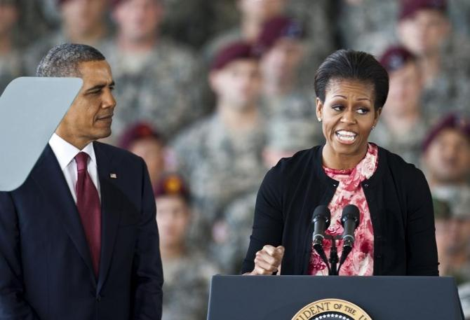 First lady Michelle Obama speaks to troops as her husband and U.S. President Barack Obama looks on at Fort Bragg in Fayetteville.