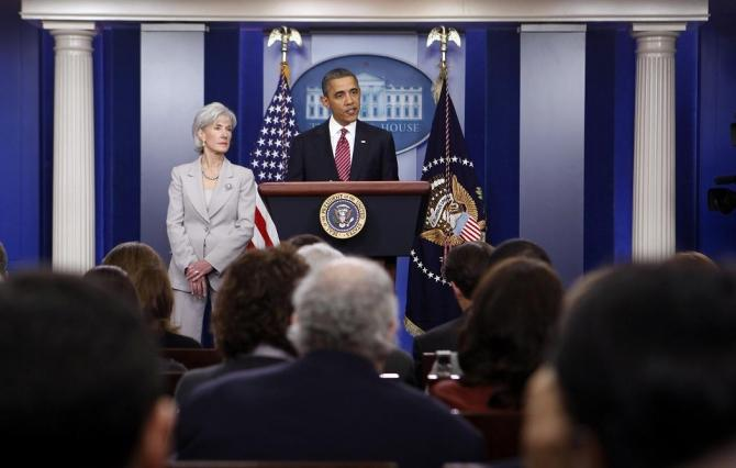 U.S. President Barack Obama talks next to Secretary of HHS Kathleen Sebelius about contraceptive care funding in the press room of the White House.