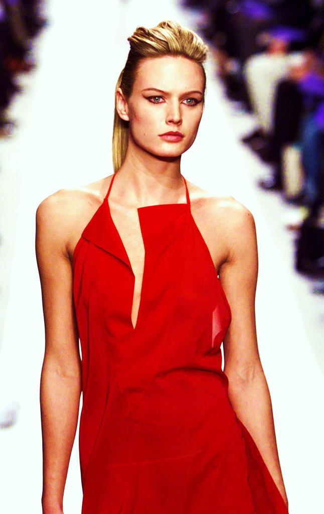 A model for Italian designer Mario Valentino presents this red long evening dress as part of his Spring-Summer 1999 Haute Couture fashion collection.