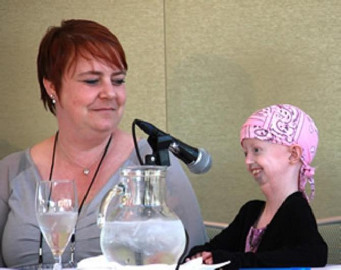 Twelve-year-old Hayley Okines (r) and her mom, Kerry, during the family panel