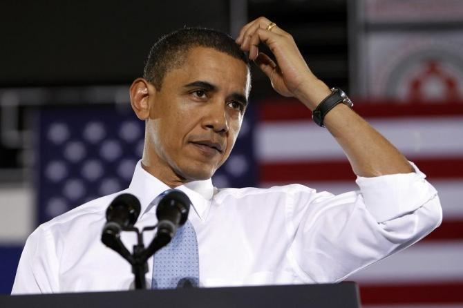 US President Obama pauses as he speaks about health insurance reform during a visit to Portland