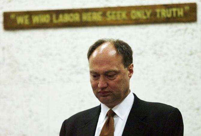 Michael Szymanczyk, President and CEO of Philip Morris USA, stands at the witness box during a court break in Miami as he testifies during the punitive damages phase of the Florida tobacco trial in 2000