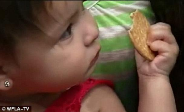 Selena Olguin was three months old when she had the tip of her finger, pictured, cut off accidentally by a nurse.