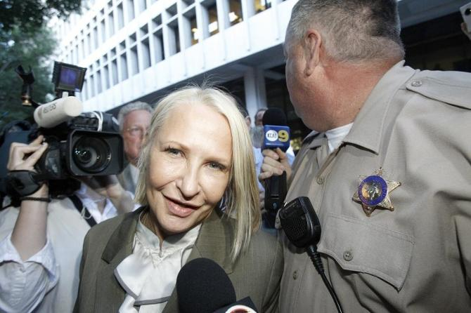 Defendant Khristine Eroshevich leaves the Los Angeles County Criminal Courts building in Los Angeles October 28, 2010. Eroshevich was found guilty on four charges, including 2 counts of conspiracy, for helping to funnel prescription medications to former