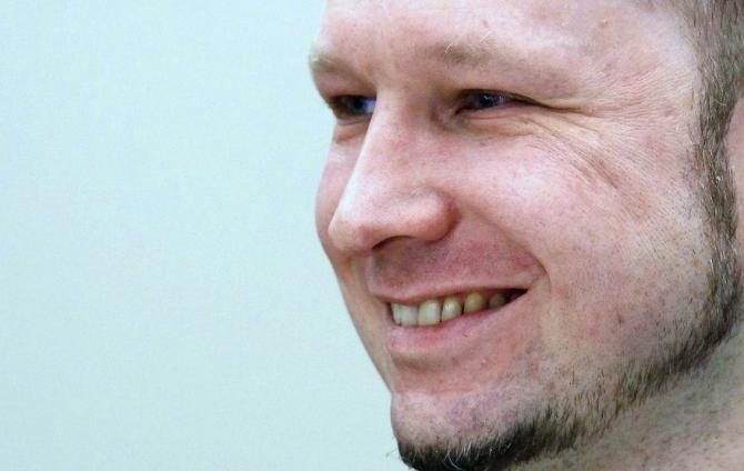 Norwegian mass killer Anders Behring Breivik smiles as he arrives in court for the second day of his terrorism and murder trial in Oslo April 17, 2012.
