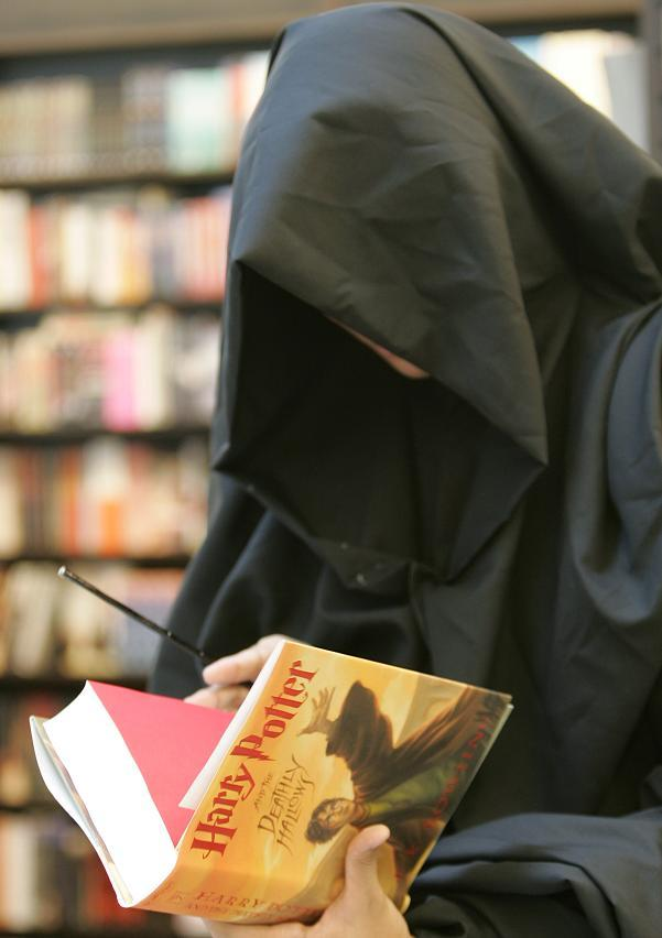 "A Harry Potter fan, dressed as the character Lord Voldemort, browses the new release of J.K. Rowling's ""Harry Potter and the Deathly Hallows"" at a bookstore in Manila July 21, 2007."