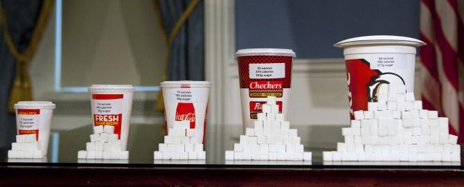 Soft drink cups of various sizes are displayed at a news conference at City Hall in New York
