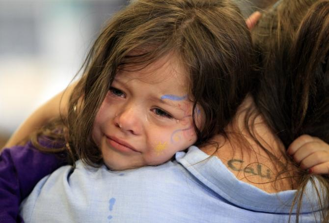 crying child with mother