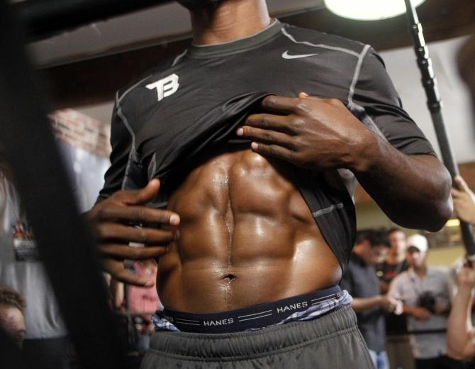 world junior welterweight champion Timothy Bradley shows his abdominal muscles