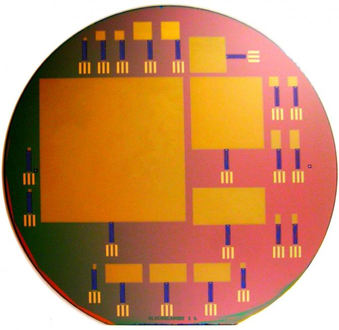 This silicon wafer consists of glucose fuel cells of varying sizes; the largest is 64 by 64 mm.