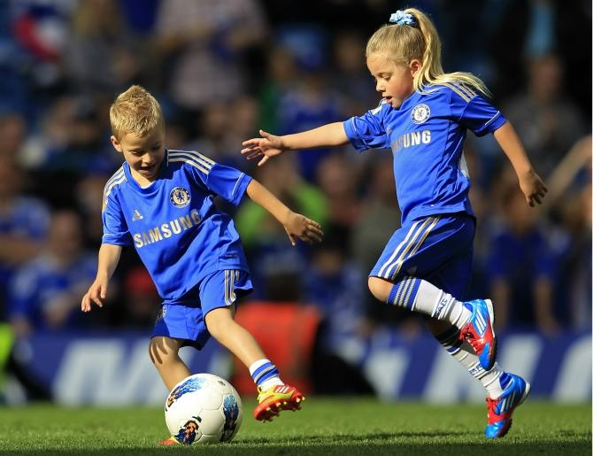 Georgie and Summer, the children of Chelsea's Terry play soccer on the pitch after their English Premier League soccer match against Blackburn Rovers at Stamford Bridge in London