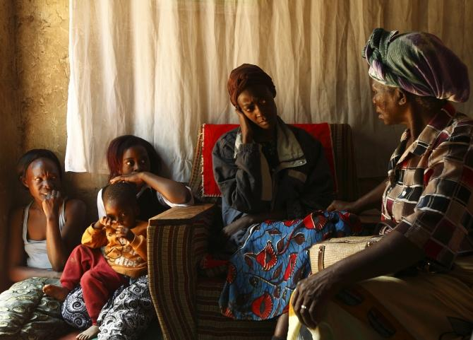 A home-based caregiver visits an HIV-AIDS patient at her home in Matero township on the outskirts of Lusaka