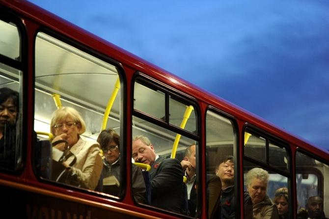 Passengers sit on the top deck of a bus in the City of London, November 10, 2011.