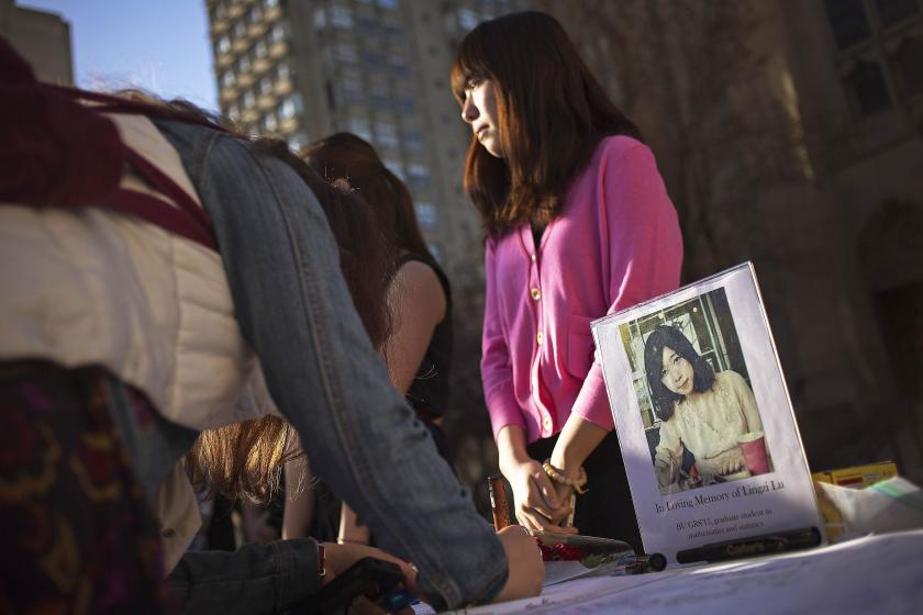 A woman mourns a victim of the Boston Marathon Bombing