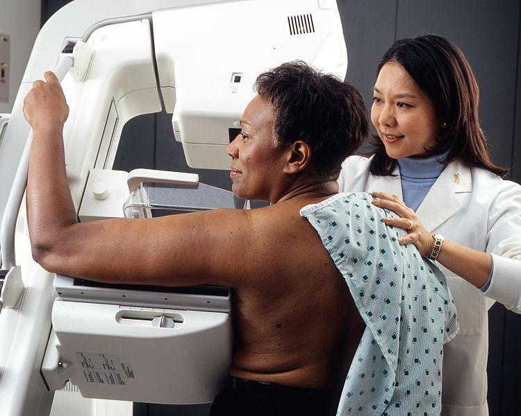 Woman receives mammogram.