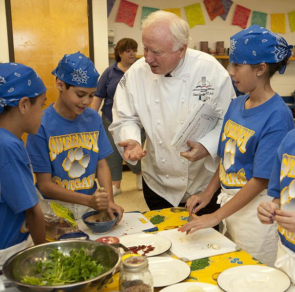 Children learning healthy eating habits from chef.