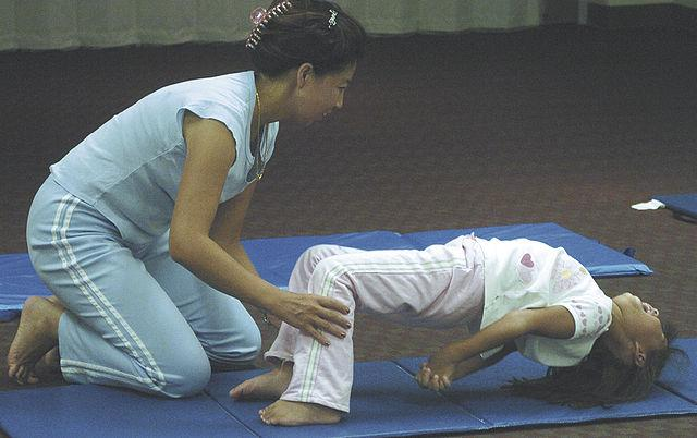 yoga being taught to a child