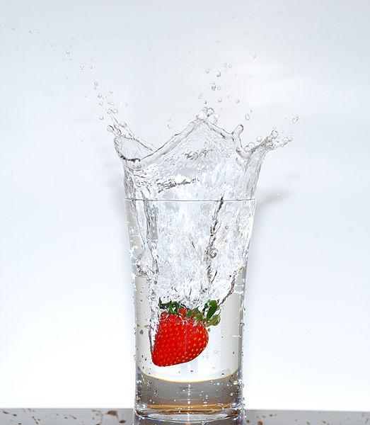 Glass of water with a strawberry