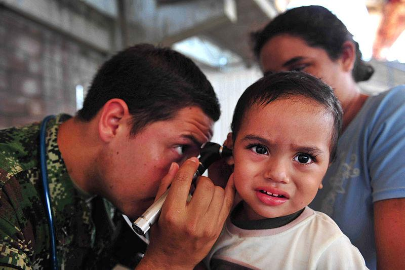 Child receiving ear examination