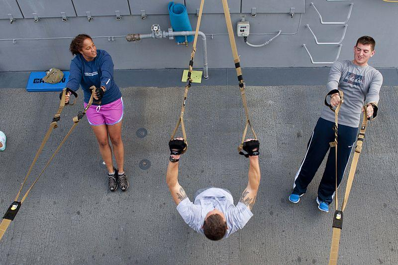 Sailors using workout resistance bands