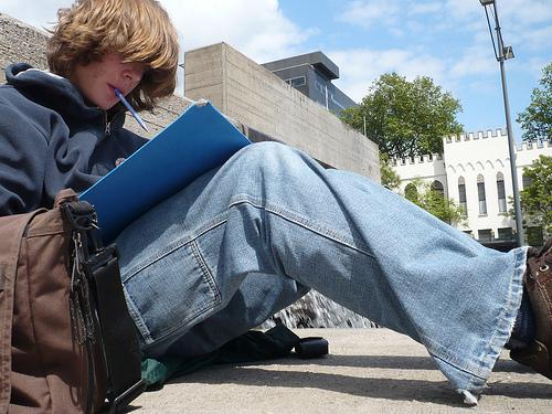 Boy studying on the ground