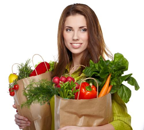 Woman holding bag of groceries