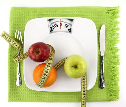 Weight scale with fruits, utensils and measuring tape