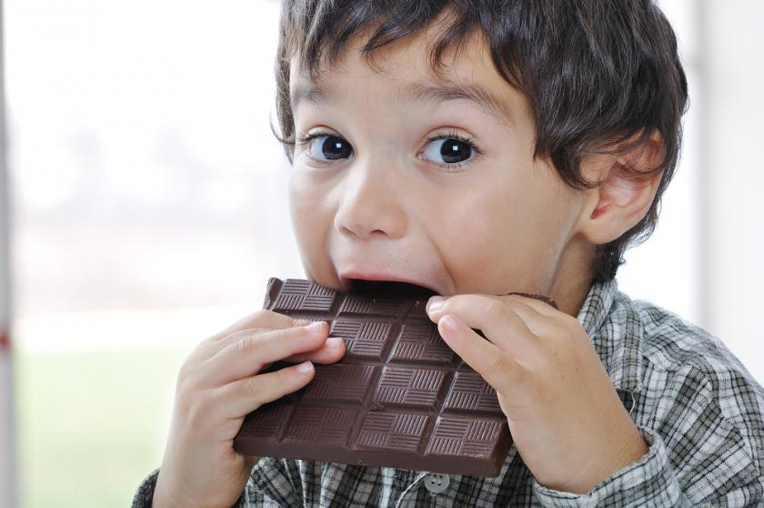 kid eating chocolate