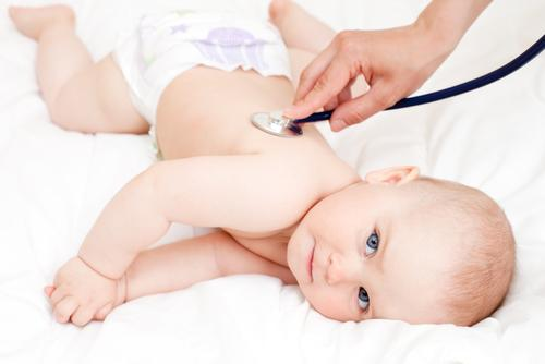 Doctor examining infant