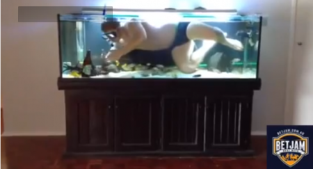 guy-necks-beer-his-fish-tank
