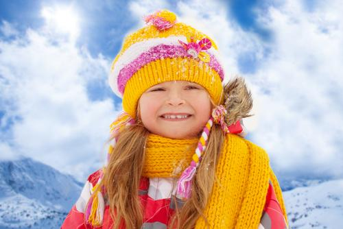 Girl dressed in yellow clothing during winter