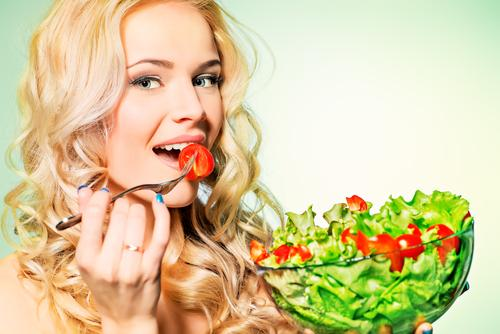 Woman eating a salad in a bowl